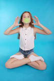 Young girl making a big bubble with a chewing gum Royalty Free Stock Image
