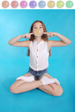 Young girl making a big bubble with a chewing gum royalty free stock images