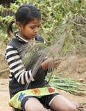 Young Girl Making Brooms Stock Photos