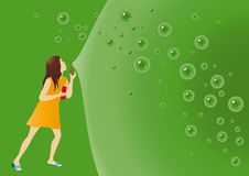 Young girl making bubbles Stock Image
