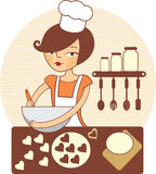Young girl making cookies. In the kitchen Stock Photography