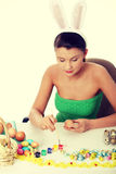 Young girl is making easter decoration Royalty Free Stock Photography