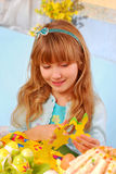 Young girl  making easter decorations Royalty Free Stock Photo