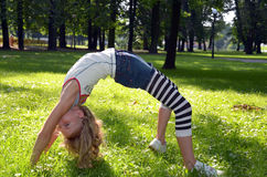 Young girl making exercise in the park Stock Photography