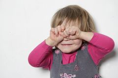 Young girl making faces. Studio shot of young girl making faces Royalty Free Stock Images