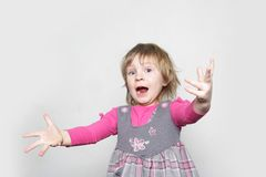 Young girl making faces Stock Images
