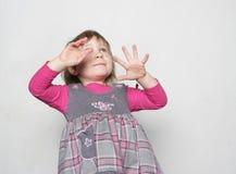 Young girl making faces Stock Photos
