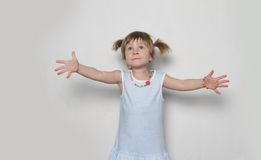 Young girl making faces. Studio shot of young cute girl Royalty Free Stock Photos
