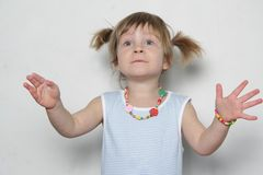 Young girl making faces. Studio shot of young surprised girl Royalty Free Stock Photo