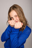Young girl making fists royalty free stock photos