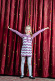 Young girl making her entrance on stage Stock Photography