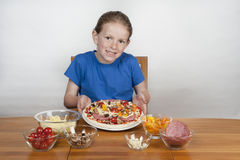 Young girl making home-made pizza Royalty Free Stock Photo