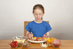 Young girl making home-made pizza Royalty Free Stock Image