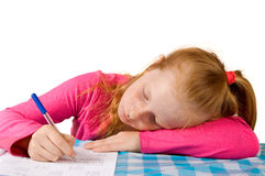 Young girl making homework Stock Images