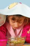 Young girl making inhalation Stock Image