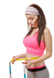 Young girl making measure around her waist with measuring tape Stock Images