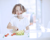 Young girl making a salad Royalty Free Stock Photography