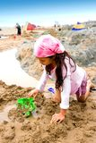 Young girl making sand castle Royalty Free Stock Photos