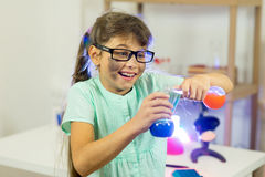 Young girl making science experiments Stock Photos