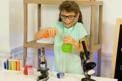 Young girl making science experiments Royalty Free Stock Photos
