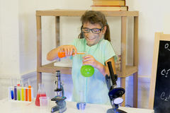 Young girl making science experiments Stock Photography
