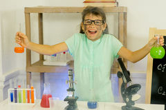 Young girl making science experiments Royalty Free Stock Images