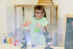 Young girl making science experiments Royalty Free Stock Photo
