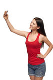 Young girl making selfie through cellphone Stock Photography