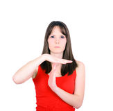 Young girl making time out gesture over white background Stock Photography