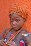 Young girl in Mali. Young girl posing in front of an old fortress in Sikasso, Mali Stock Photography
