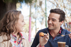 Young girl and man driking a capopuccino Royalty Free Stock Image
