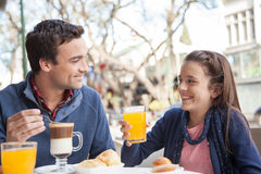 Young girl and man drinking juice Royalty Free Stock Photography