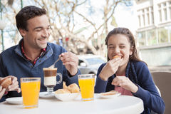 Young girl and man have fun in the street Stock Image