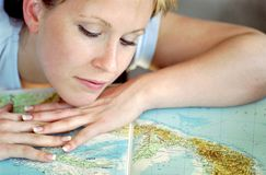 Young girl and map Royalty Free Stock Image