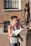 Young girl with a map in Amsterdam Stock Photography