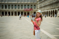 Young girl with map at San Marco square in Venice Royalty Free Stock Image
