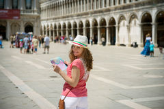 Young girl with map at San Marco square in Venice Royalty Free Stock Images