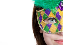 Young girl in a mardi gras mask with copy space Stock Images