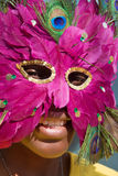 Young girl with mask Royalty Free Stock Image
