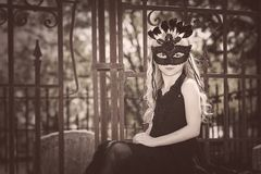 Young girl mask. Cemetery vintage Royalty Free Stock Photos