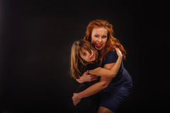Young girl and mature mother embracing Stock Photos