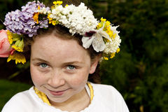 Young girl with may day floor wreath. 9 year old girl with flowers on hair Stock Images