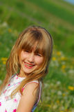 Young girl  on meadow Stock Photography