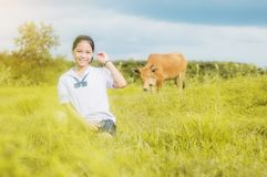 Young girl in meadow contryside nature. In evening light Royalty Free Stock Image