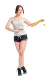 Young girl measuring her waist centimeter Royalty Free Stock Photos