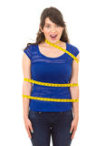 Young girl with measuring tape around her body Stock Photography