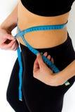 Young girl measuring waist Stock Image