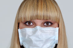 Young girl in a medical mask Royalty Free Stock Photo