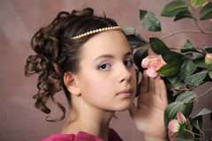 The young girl in a medieval dress with a rose Royalty Free Stock Images