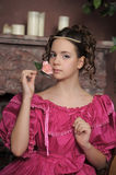 The young girl in a medieval dress with a rose  Royalty Free Stock Photo